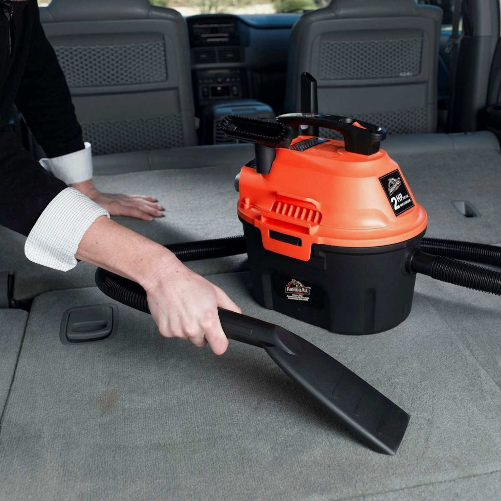 vacuum cleaner used to get dog hair out of car carpet
