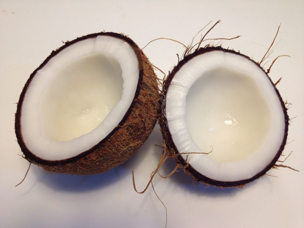 best way to clean dogs teeth | Coconut split in half