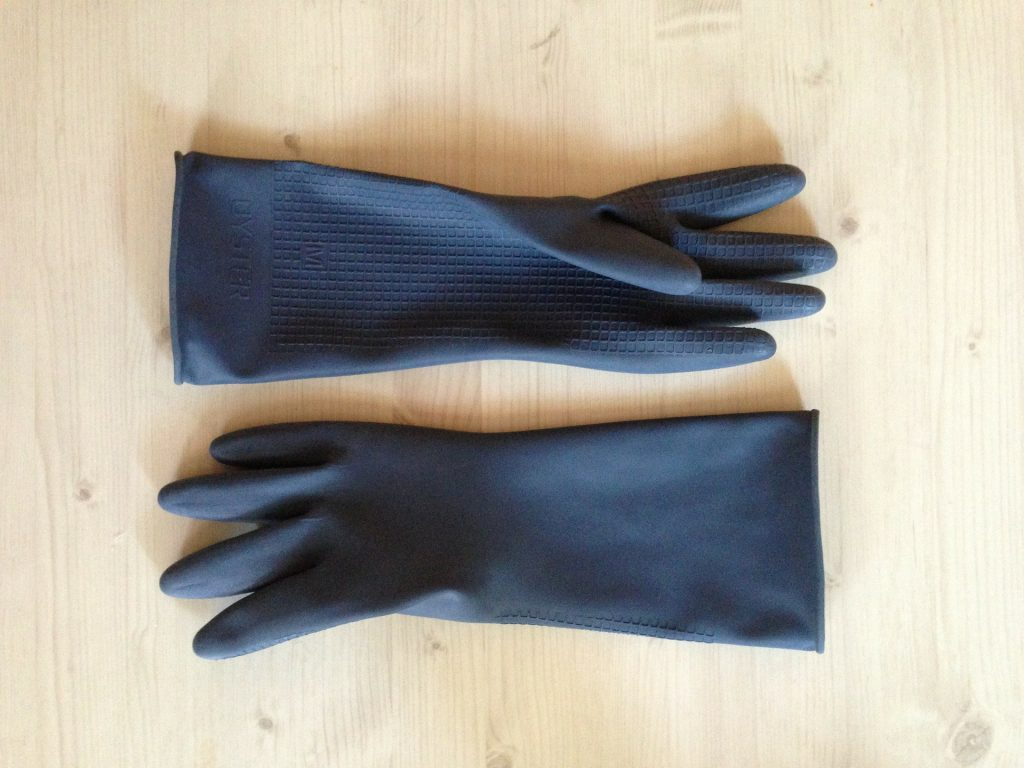 How to Get Dog Hair Out of Clothes Using  Static Electricity | A pair of latex/ rubber gloves.