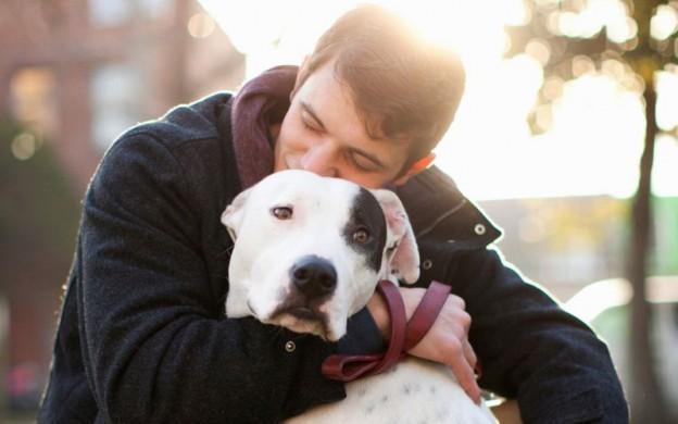 man hugging his dog. emotional support dog training