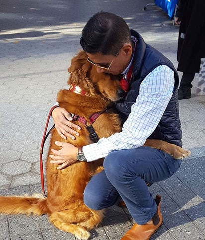 man hugging his ESD. emotional support dog training