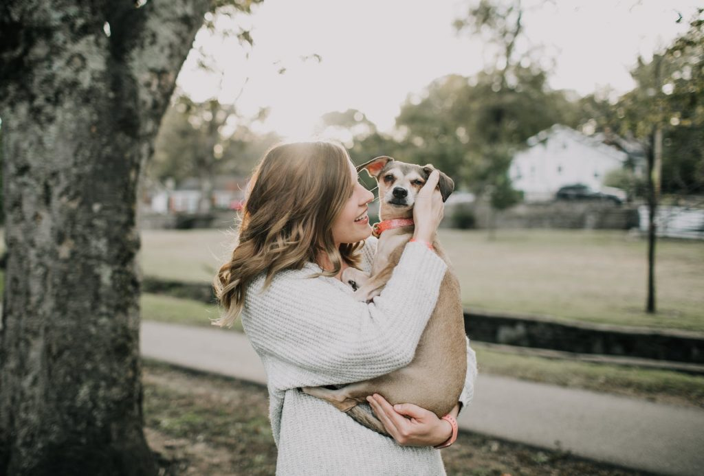 woman kissing her ESD. Emotional Support Dog Training